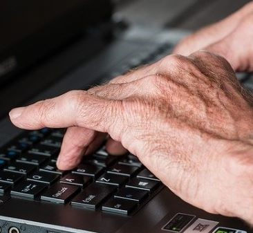 Image of hands, typing on keyboard